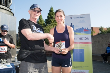 Overall Female Winner, Sara McCuaig, with John Q. Trojanowski, MD, PhD, Director of the IOA